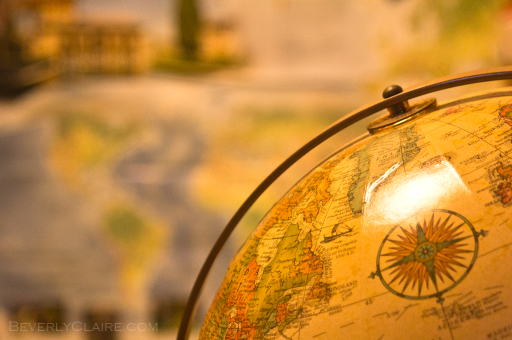 A globe at home. Behind is a UNESCO map.